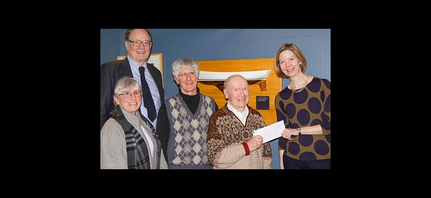 Lonnie Robinson presents a check to Philosophy Chair Andrea Woody. Also present are (from left) History Professor Emeritus Thomas Hankins and Lonnie Robinson's son and daughter, Larry Robinson and Jane Ritchey .