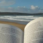 Open book in foreground with beach in background
