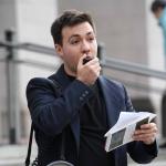 Alex Lenferna speaking into a megaphone