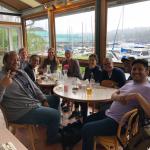 Neuroethics group sitting around table at Agua Verde restaurant