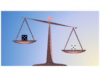Black and white dice on a loaded scale, the white dice weights heavier although they look the same size