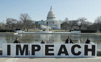 Large impeach sign in from of Capitol Building