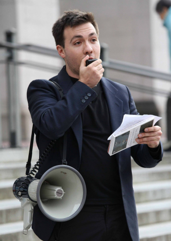 Alex Lenferna speaking into a megaphone