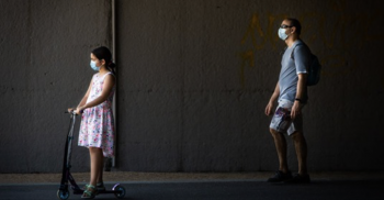 Child and parent both wearing face masks