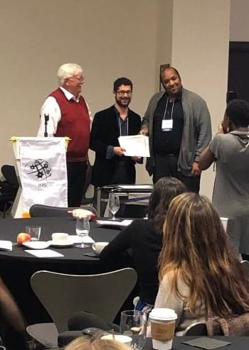 Tim Brown receiving award