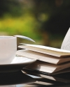 Stack of books and tea cup