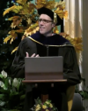 Ian Schnee addressing the new student convocation