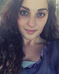 Headshot of a dark-haired woman