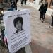 Image of sidewalk with poster of  Dzhokhar Tsarnaev titled FBI/CIA fall guy